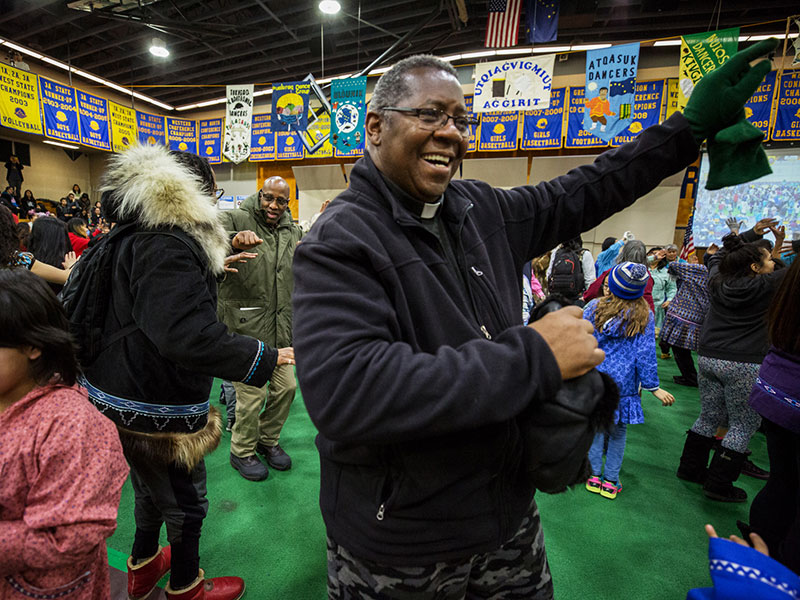 The Rev. Joseph Reid and the Rev. Dr. J. Herbert Nelson, II, (in the background) join in celebratory dancing during the renewal and healing event in Utqiagvik. (Photo by Bill Hess)