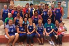 St. Charles Avenue Presbyterian Church helped fund the expansion of an outdoor kitchen at El Fuerte church in Cardenas, Cuba. The kitchen was dedicated in 2017. SCAPC's Presbyterian Women donated aprons with the church's logo to the women of El Fuerte. (Courtesy of SCAPC)