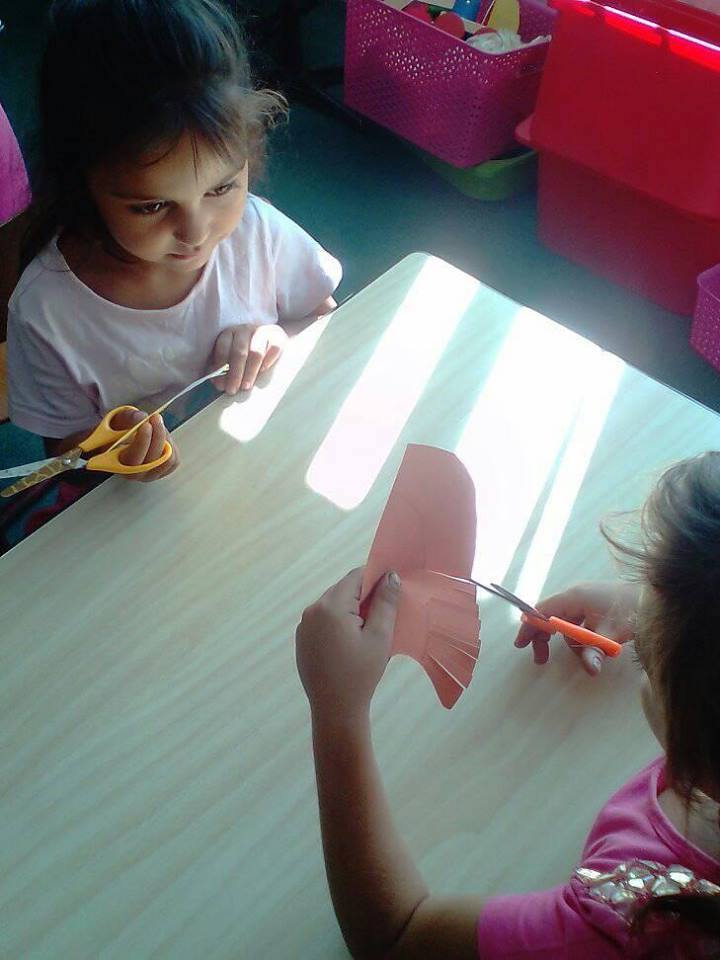 Crafts, drawing and cutting using safety scissors.