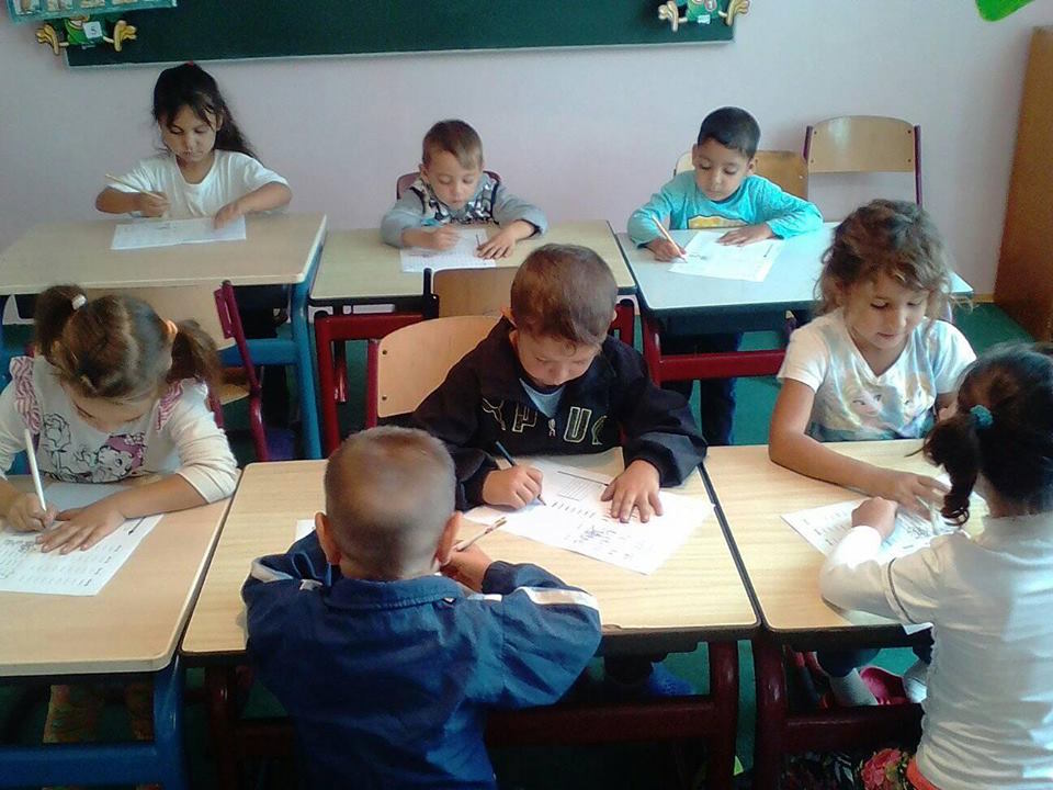 Four and five year olds learning to write.