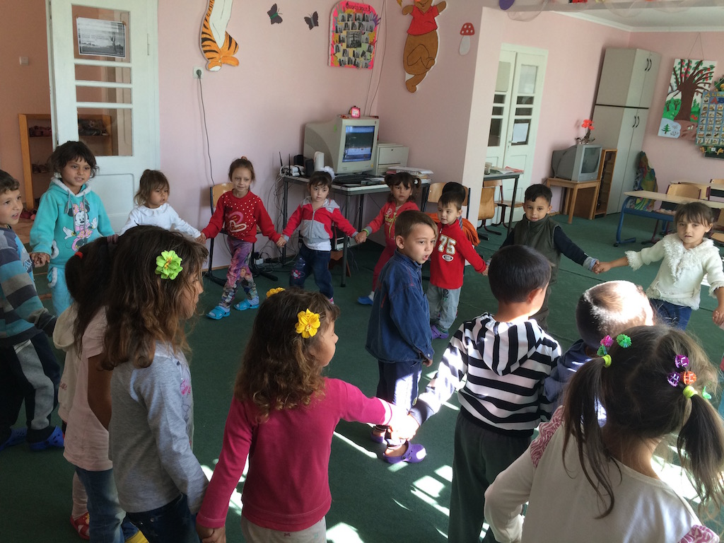 Older children teaching younger children songs and dance.