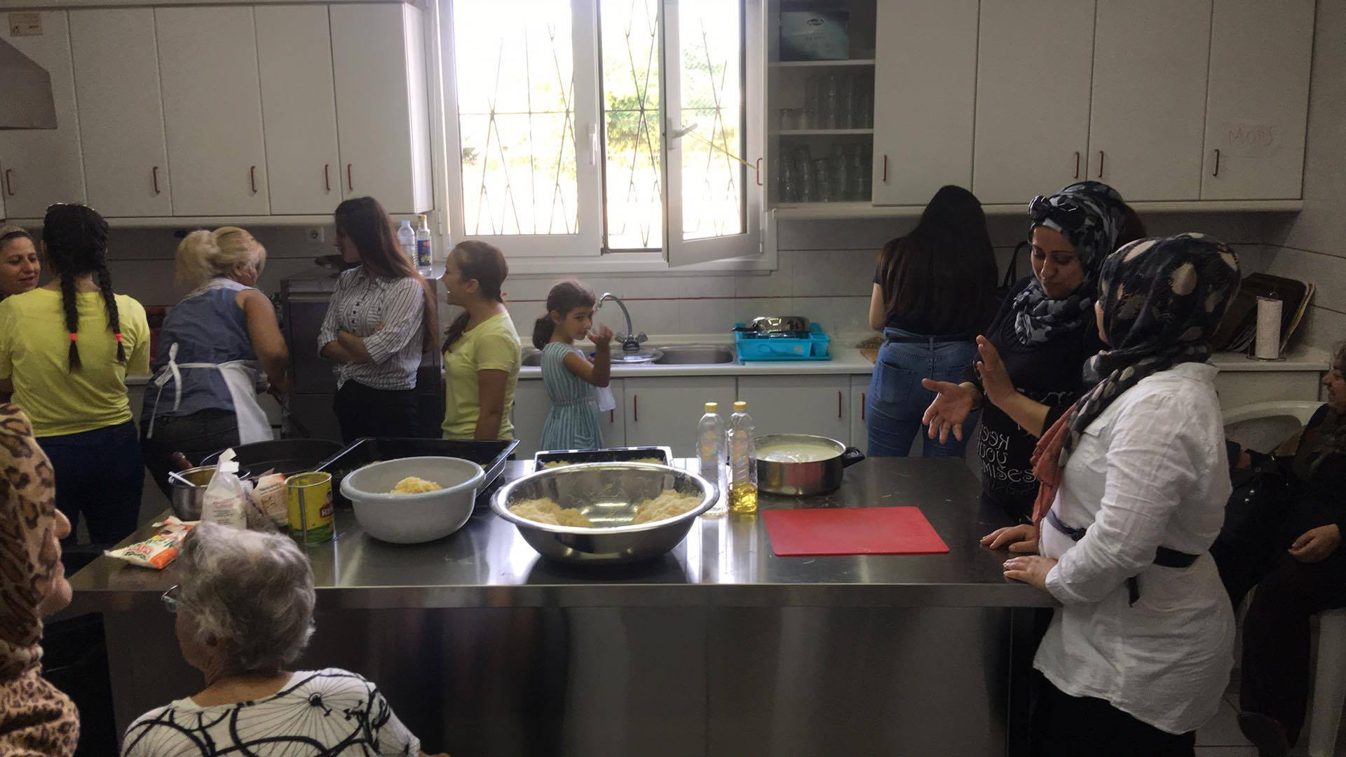 A time for sharing and talk as the women bake sweets.