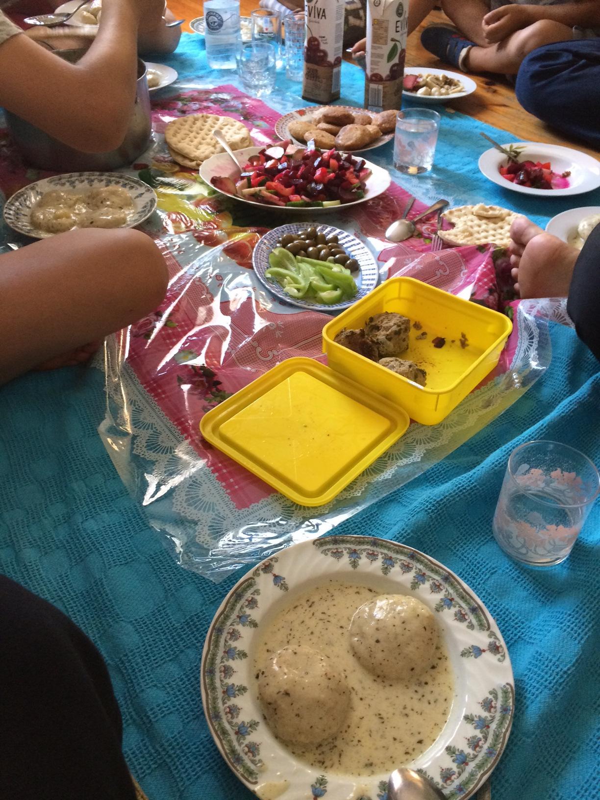 Building friendships by sharing an Iraqi specialty kofta bel ladin.
