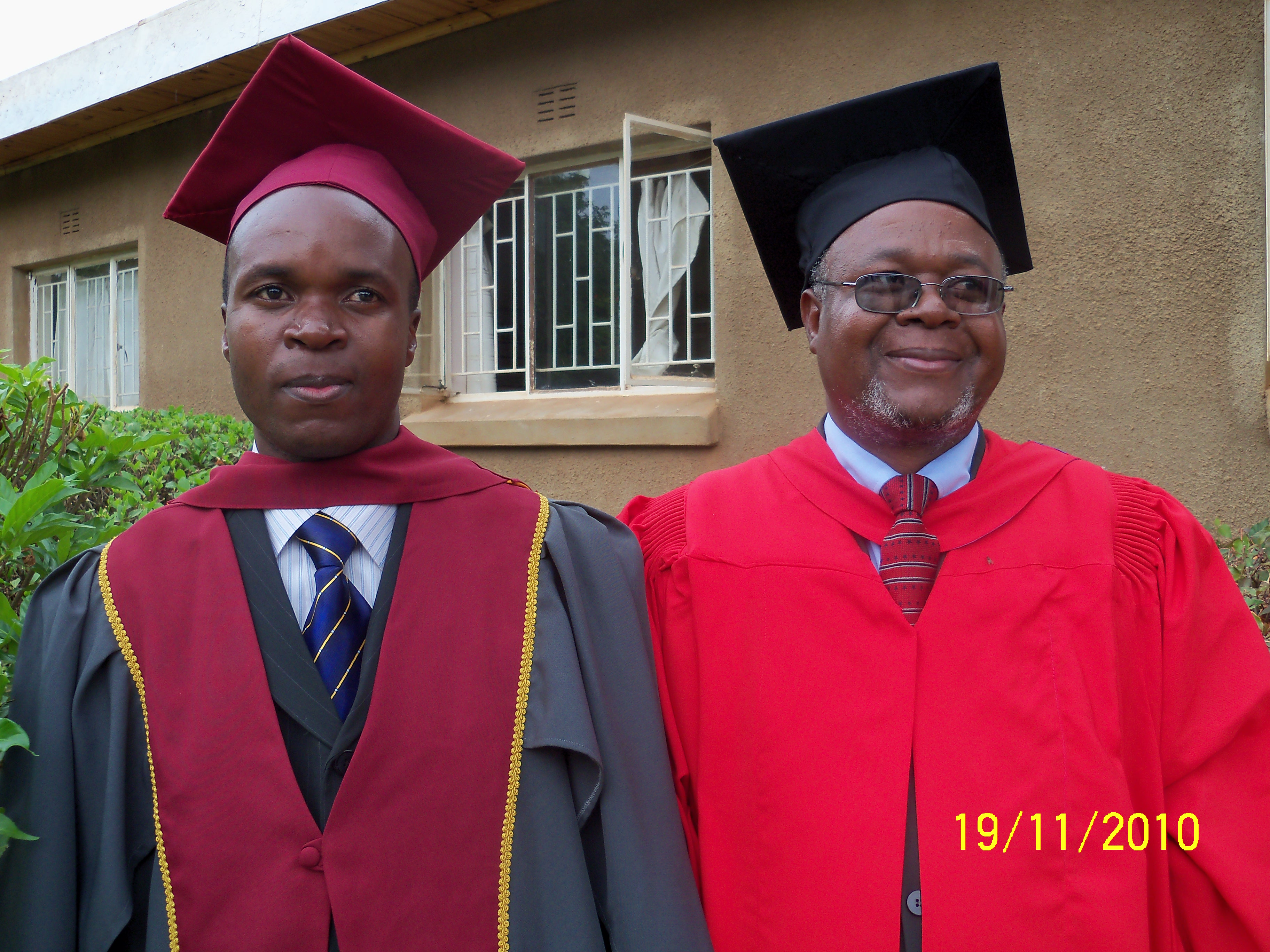 Dr. Chilenje with young brother Lazarus, who was raised by Dr. Chilenje and followed in his footsteps. Photo is from Lazarus Chilenje's graduation from Justo Mwale Bachelor of Theology program in 2010.