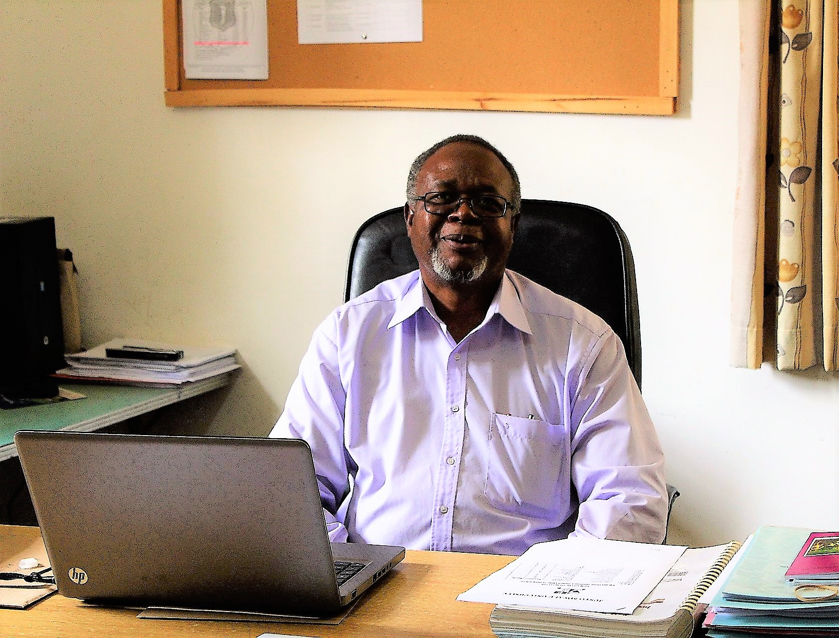 Dr. Chilenje in his office at Justo Mwale University, where he is now serving as Deputy Registrar, Academic Affairs.