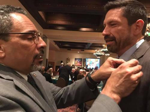 Tony De La Rosa (left) exchanges a PC(USA) pin for a Santa Fe pin with the city's mayor, Javier Gonzales, at a banquet celebrating the 150th anniversary of First Presbyterian Church of Santa Fe. (Photo provided)