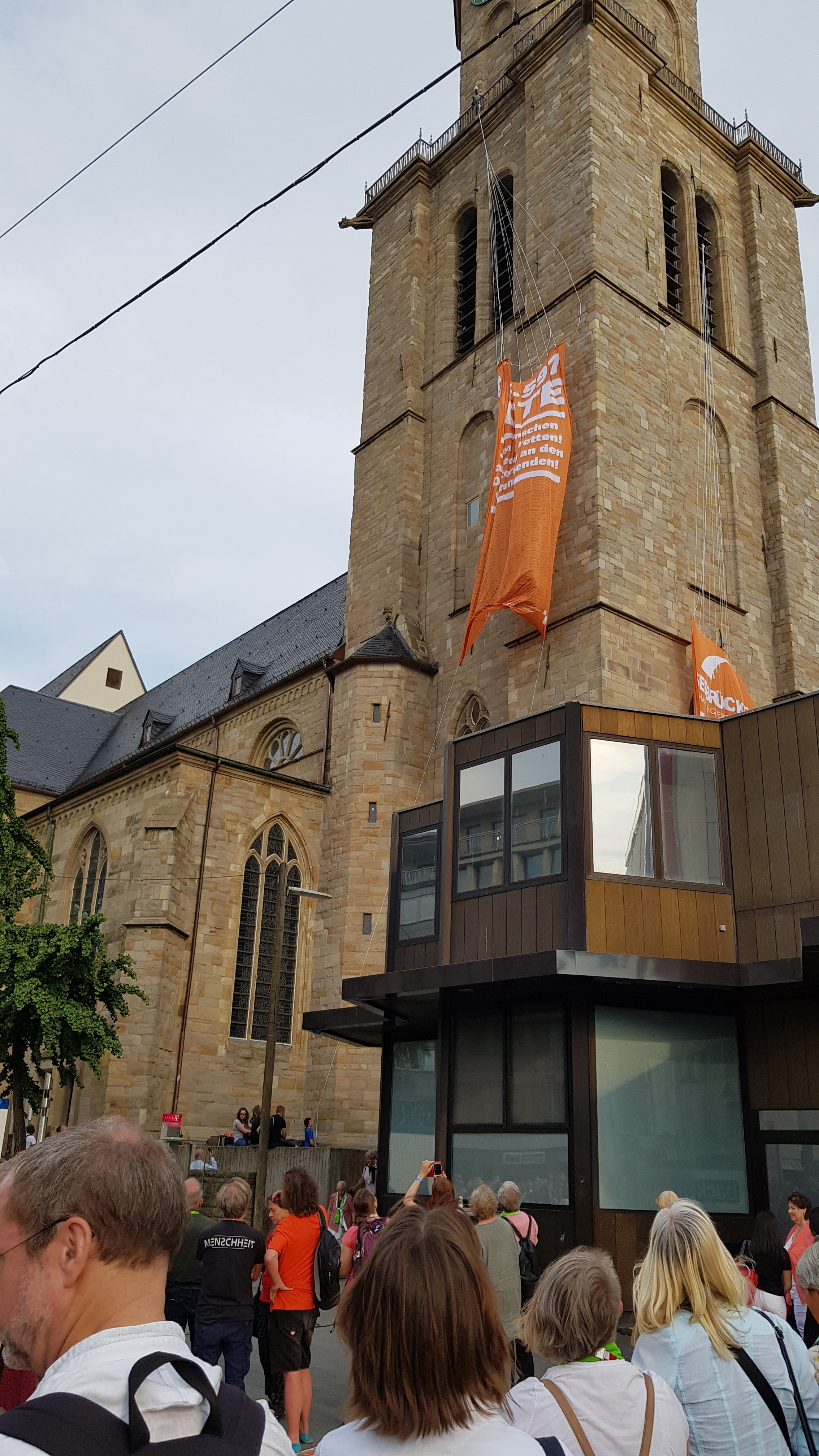 Banner with names of drowned refugees lifted at the church steeple in Dortmund. (Photo: Burkhard Paetzold)