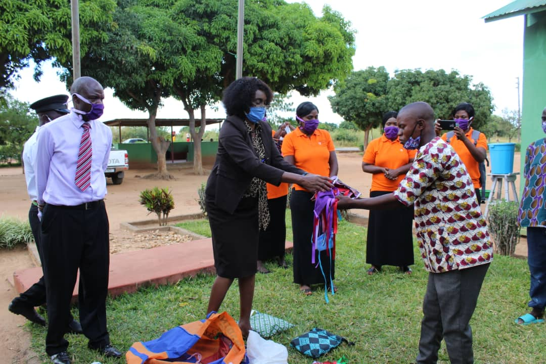 Lundazi Correctional Prison receives face masks from CCAP of Zambia's health department. Mr. Richard Willima (wearing the tie) is the coordinator for CCAP's health department. (Photo by Cynthia Mtalanga)