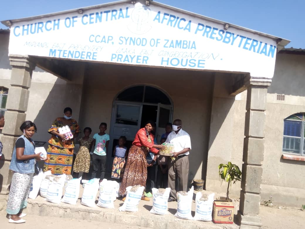 Food distribution by the community schools' coordinator, Mrs. Mabuchi Ndhlovu Dokowe, for students at the Mandevu Community School of the Church of the Central Africa Presbyterian of Zambia (CCAP). Photo by Jack Mgwata.