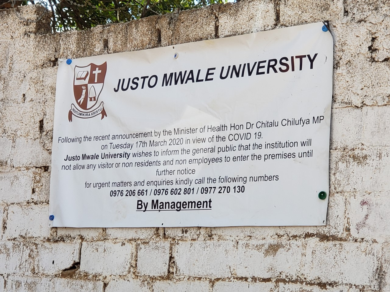 Banner hanging on the wall at the entrance to Justo Mwale University. (Photo by Rev. Paula Cooper)