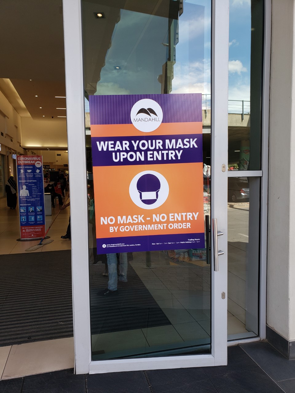 The signs on the entrance to the Manda Hill Mall. (Photos by Rev. Paula Cooper)