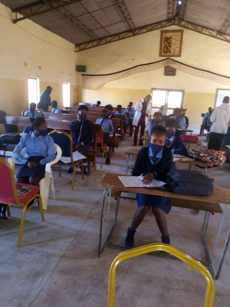Ninth grade students at Chawama Community School of the Church of Central Africa Presbyterian (CCAP) having their lesson in the Chawama Church of Central Africa Presbyterian Church building, while observing social distancing. (Photo by Jack Mgwata)