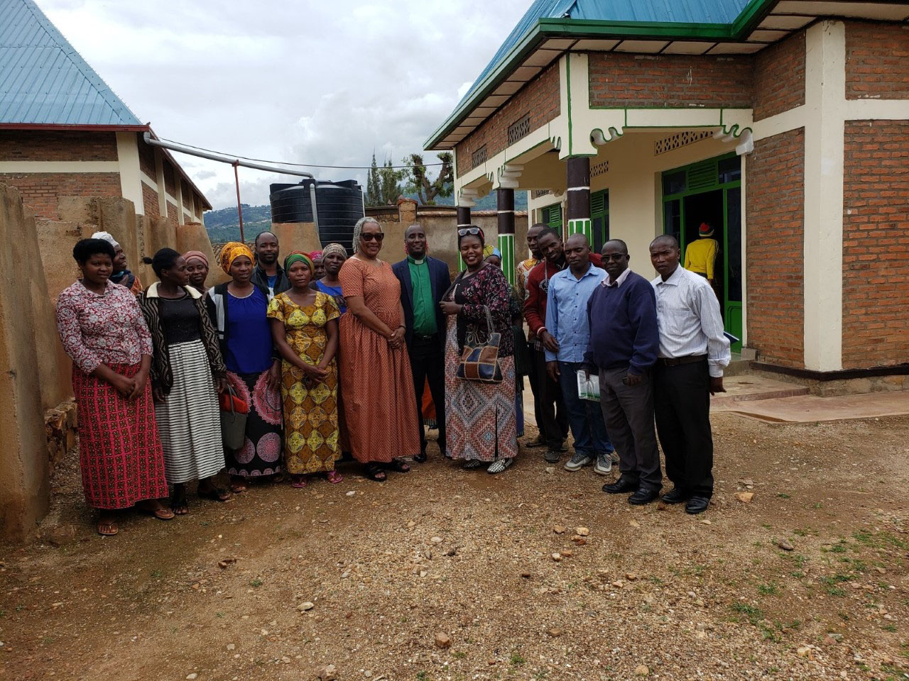 A group picture of some of the members of the savings program at Sure Parish, in the Rubengera Presbytery.