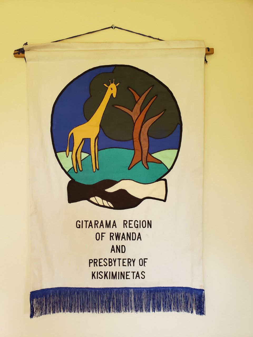 Banner hanging in the president's office at the Gitarama Presbytery of their partnership with the Presbytery of Kiskiminetas.
