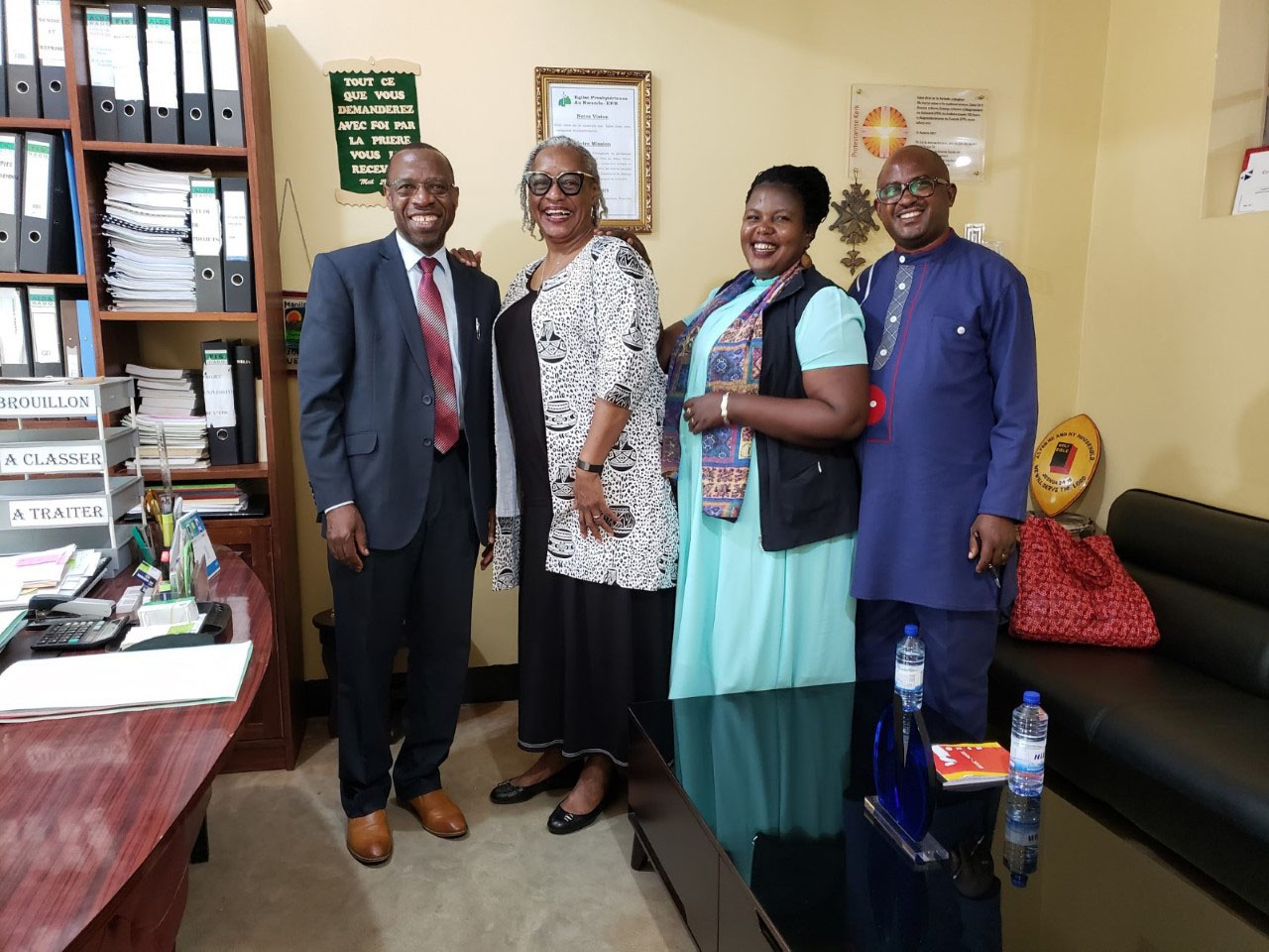 Meeting in the office of EPR president, Reverend Dr. Pascal Bataringaya's (on my right); along with the vice president, the Reverend Juile Kandema (to my left); and, the partnership office, the Reverend Emmanuel Muhozi (to my far left).