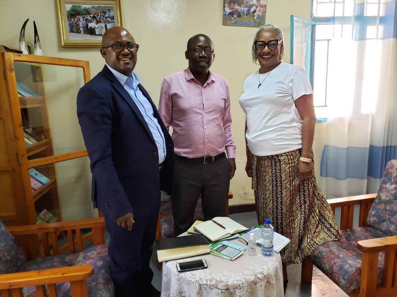 Meeting at the Center for Training and Documentation (CFD) with the coordinator, the Reverend Celestin Nsengimana (centered).