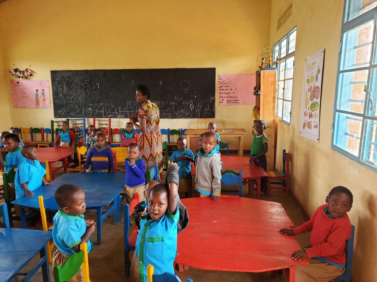 Nursery school-aged children and teacher at Kinihira Sub-parish.