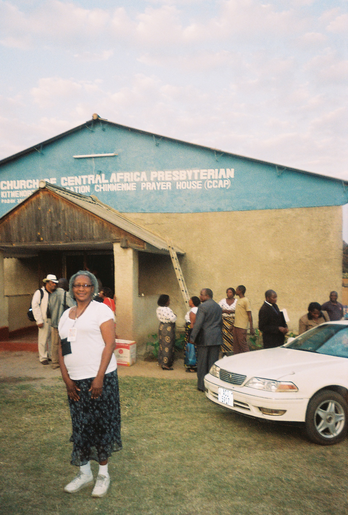 Standing outside the Central Church of Africa Presbyterian (CCAP), Kitwe North Chimwemwe Prayer House (2010).