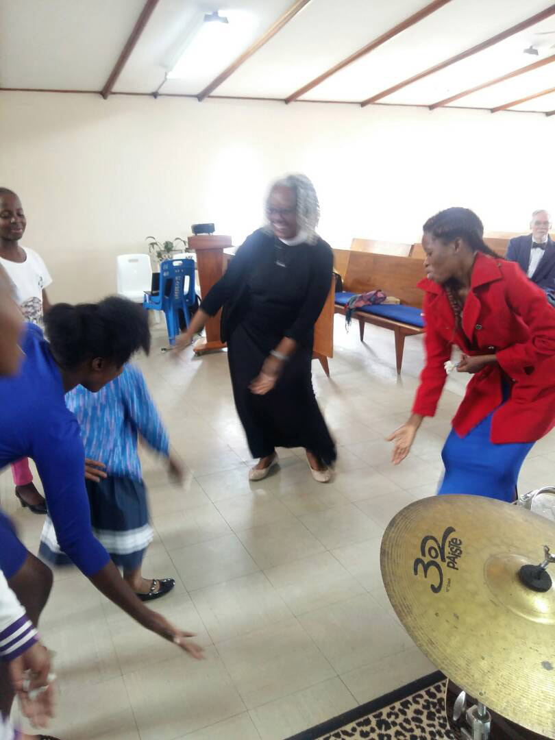 Dancing with youth after a worship service at St. Andrews Presbyterian Church, where I preached, in Kitwe, Zambia in 2018. Photo taken by church member.