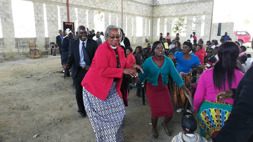 Dancing with church members of the Church of Central Africa Westlake Hills Prayer House - in the Kanyama community of Lusaka, Zambia - as we celebrated the birth of the church, Pentecost Sunday.  Photo taken by Kingsley Chirwa.