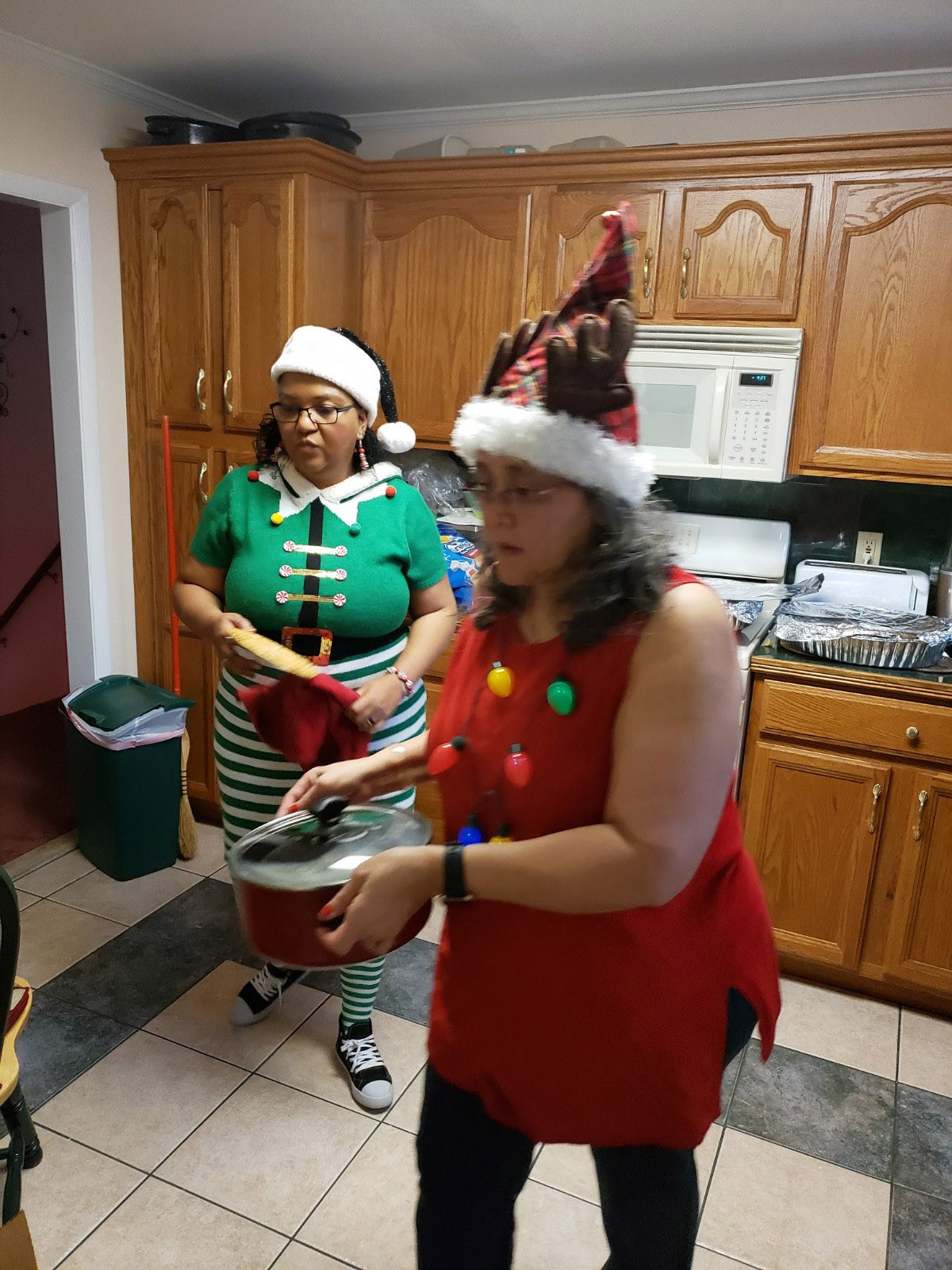 My sister, Renee, (in Christmas hat) and cousin, Anissa, (in elf custom) preparing Christmas dinner at Renee's home in King of Prussia, PA. Photo by Paula Cooper.