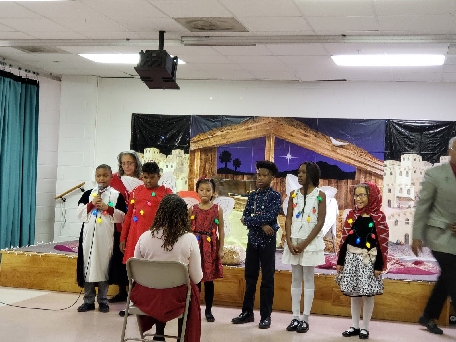 My sister Renee (back row) and her Sunday school class performing a Christmas program.  My great niece is in the red and black dress. Photo by Paula Cooper.