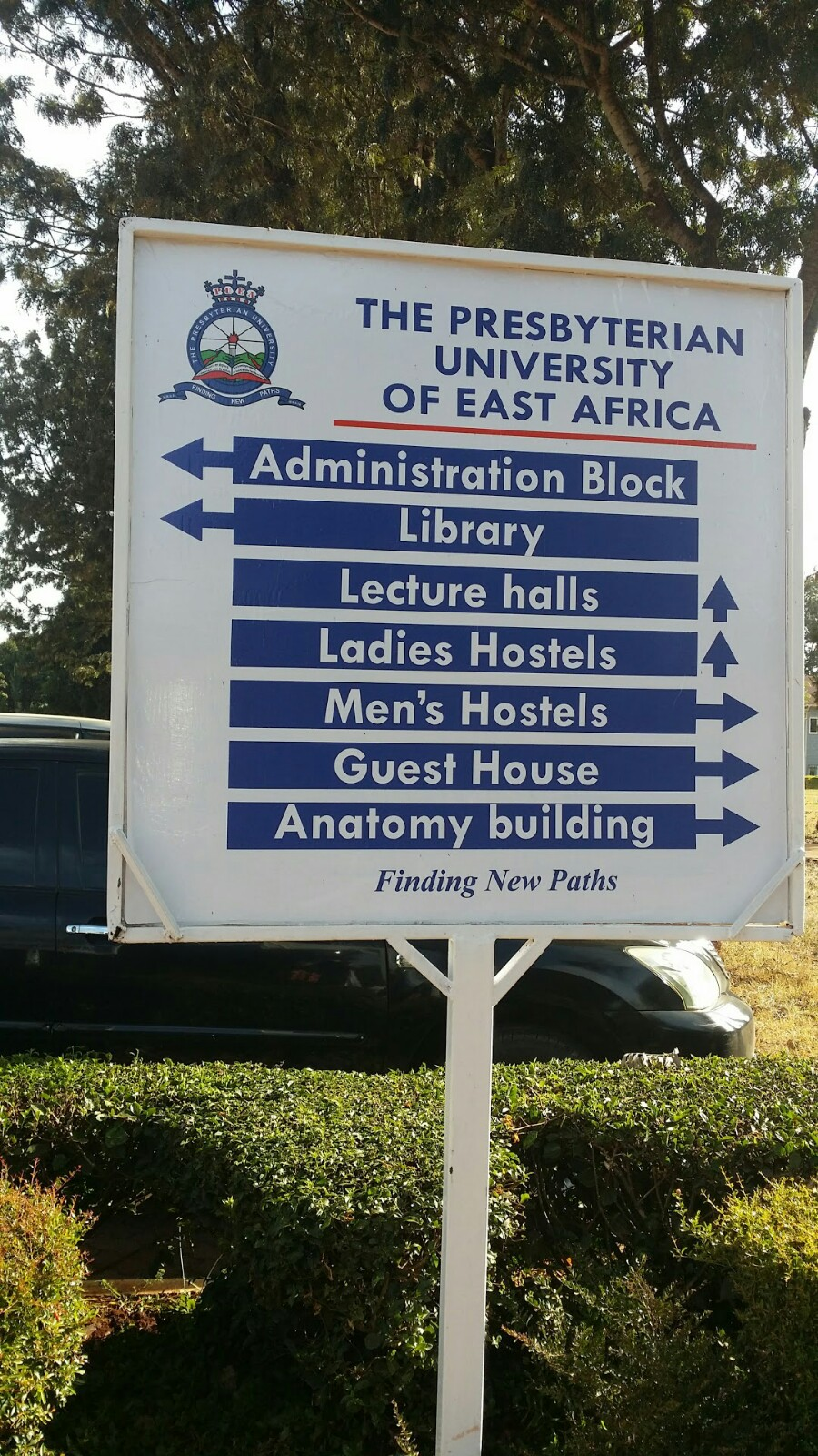 A sign directing visitors at the Presbyterian University of East Africa in Kenya.