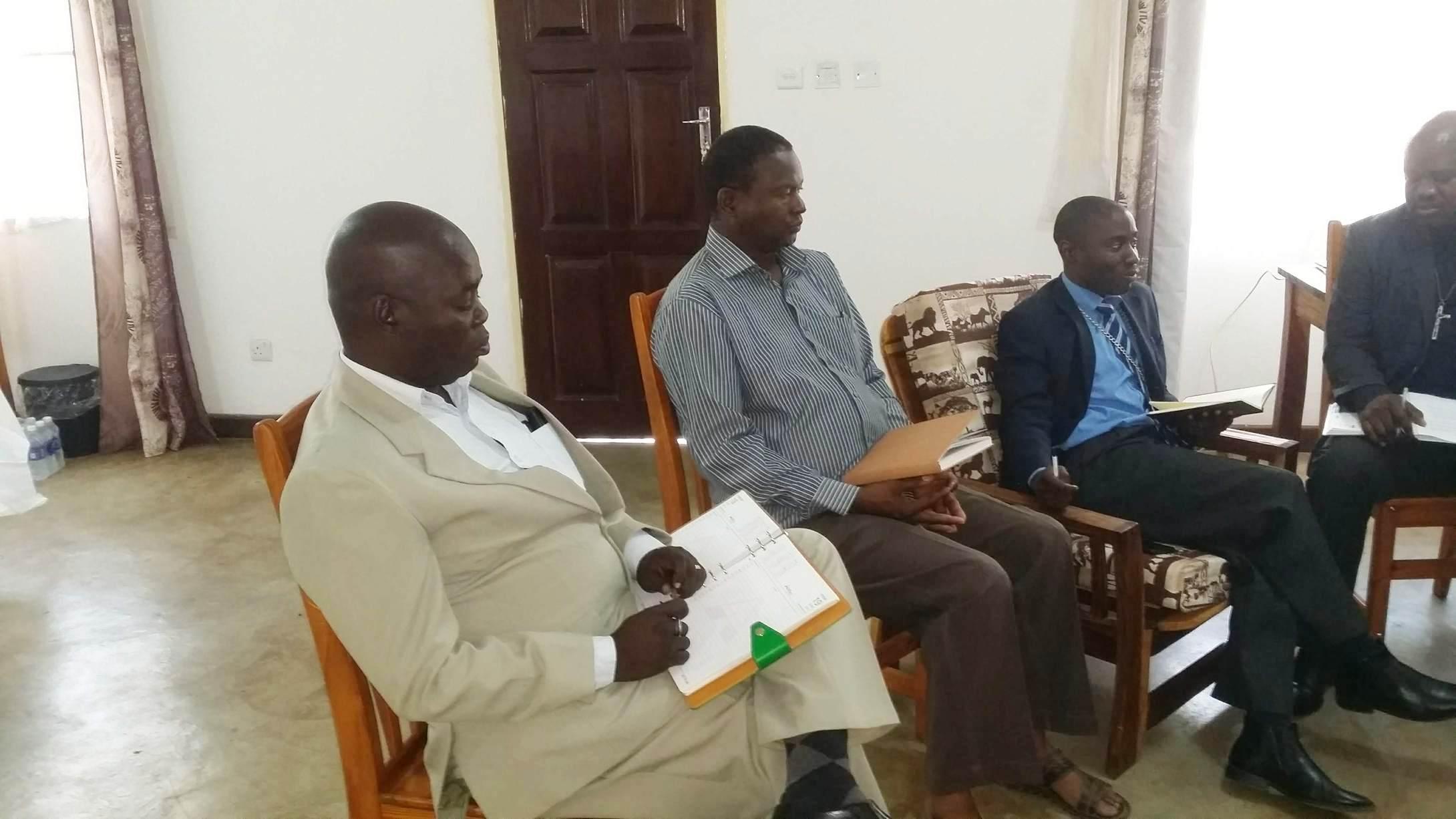 (from left to right): Reverend Daniel Tembo, CCAP's deputy general; Abraham Banda; Reverends Sevatt Kabaghe and Friday Kapasaka.