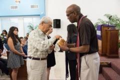Stated Clerk J. Herbert Nelson II serves Communion at Iglesia Presbiteriana de Puerto Nuevo. (Photo by Gregg Brekke)