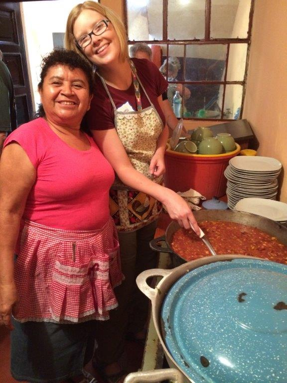 Accompanying partnerships. Helping in the church kitchen as U.S. visitors and Guatemalans celebrate their partnership together.