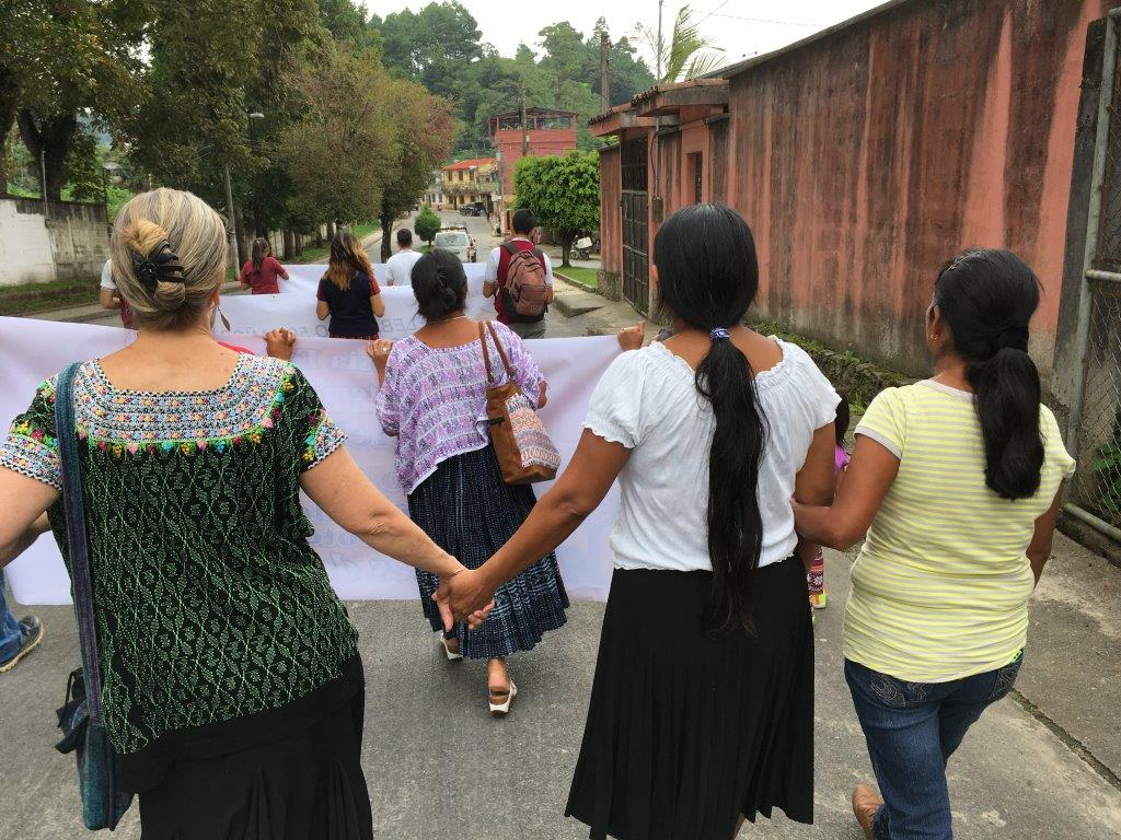 Debbie walking with Leonor, a member of Antioquia Church.
