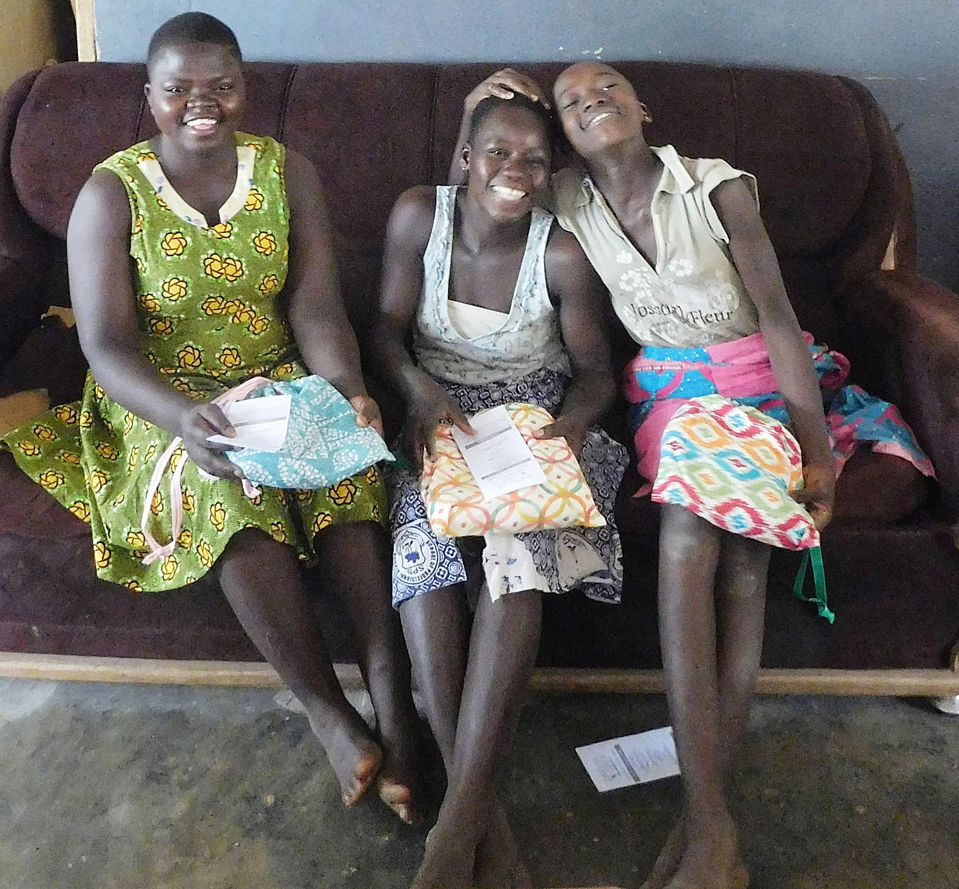 """Esther, Juliet and Doris with """"Days for Girls"""" kits."""