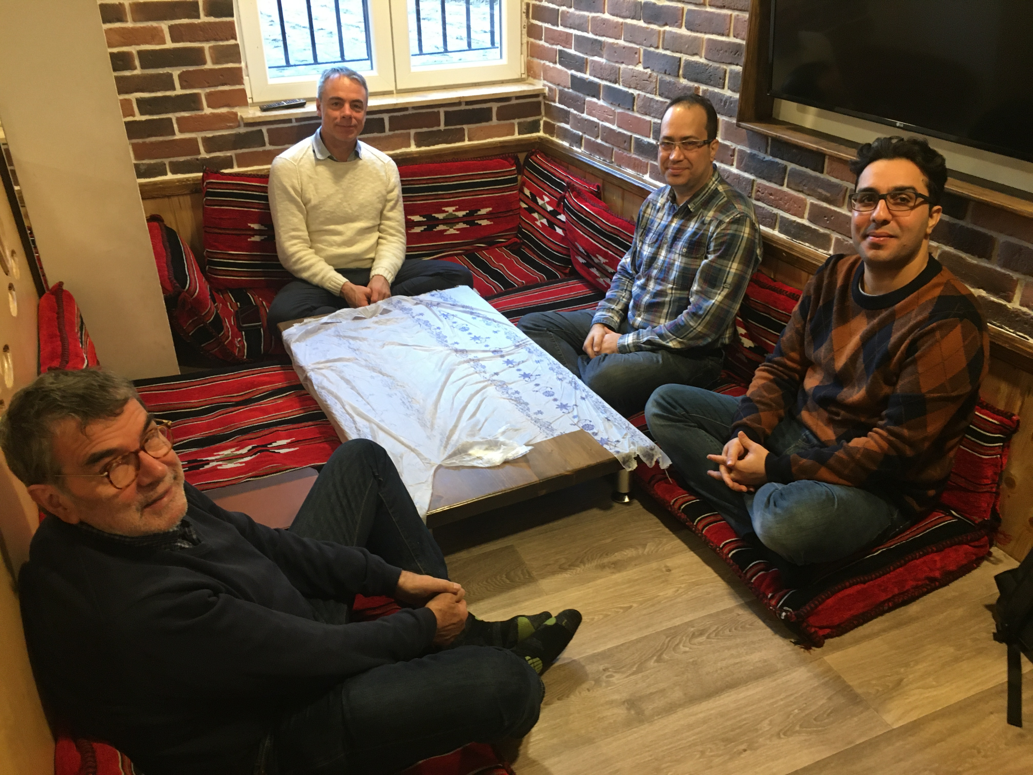 Luciano Kovacs and Burkhard Paetzold (both PC(USA) staff) have lunch and conversation together with members of the Iranian Church and Ryan during a visit to Berlin this winter.