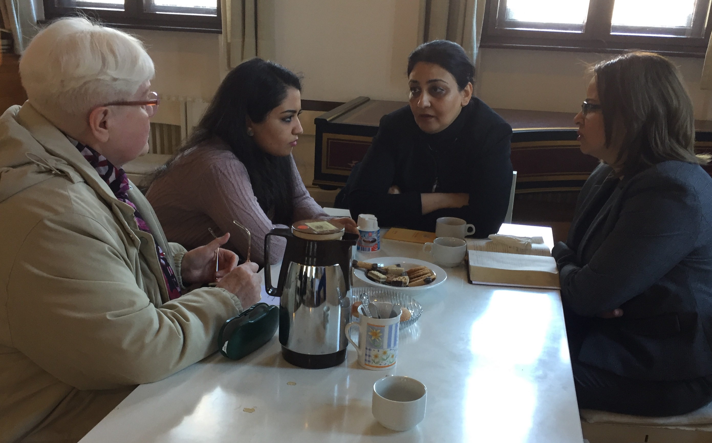 Women from the Iranian Church and German Church sharing conversation during a joint community gathering.
