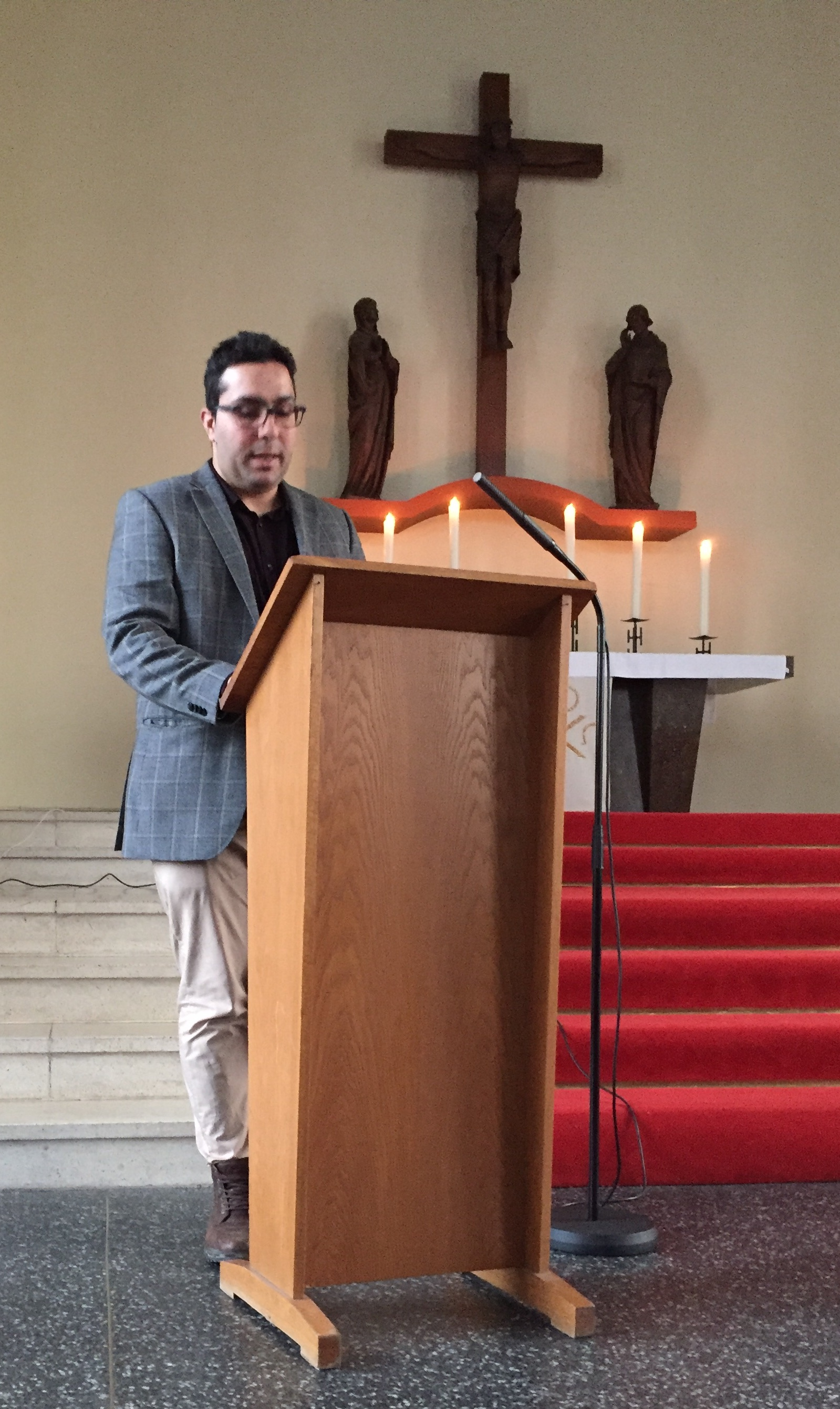 Javeed sharing during the sermon at the Refugee Church.