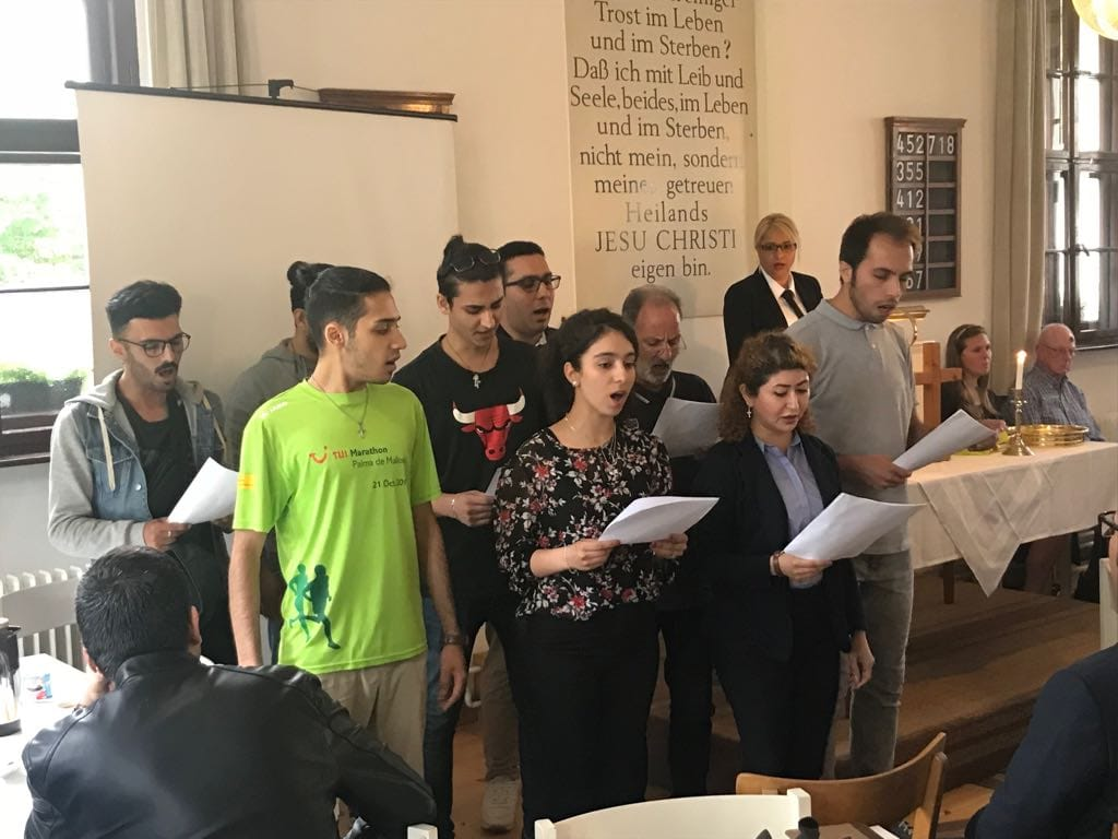 Members of the new music group in the Iranian Presbyterian Church singing in a worship service.