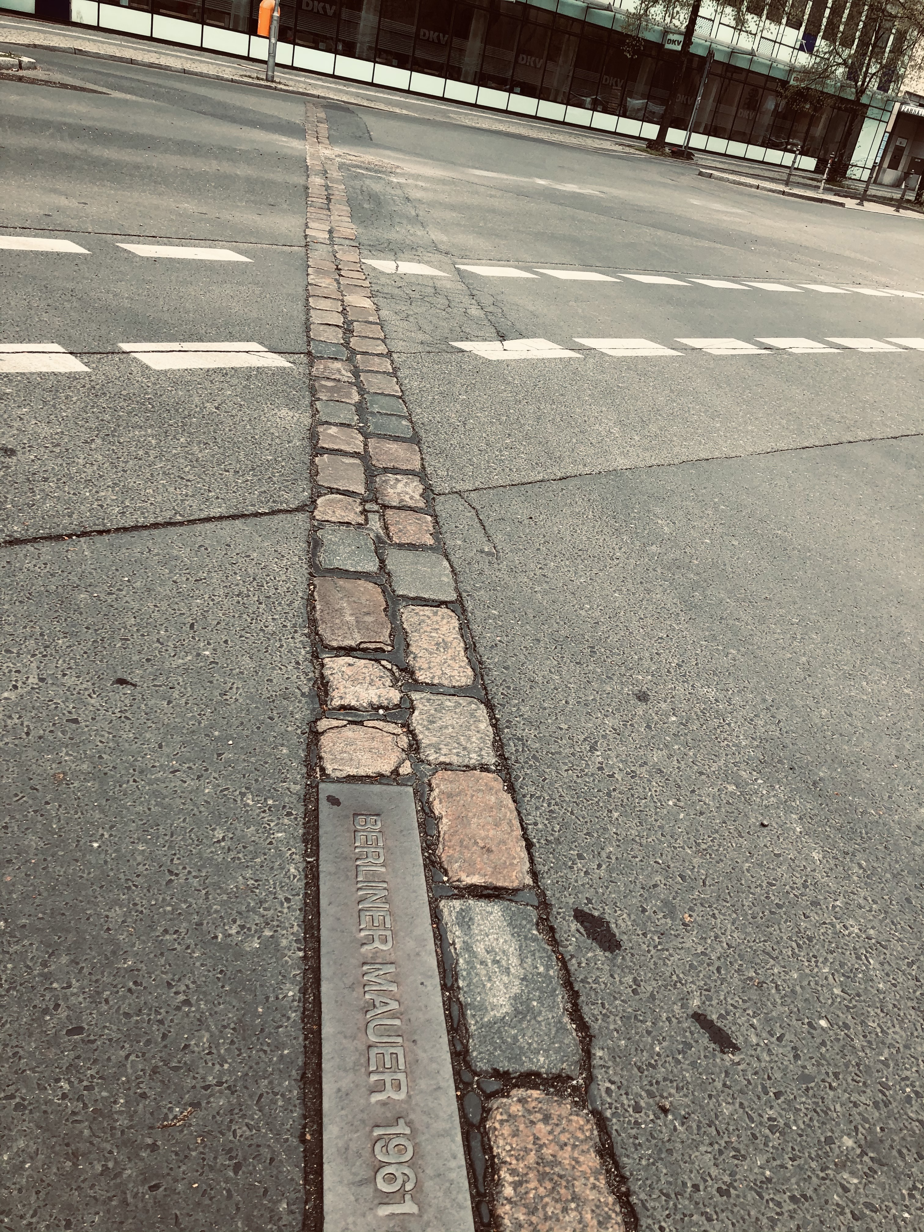 The double brick line showing how the wall divided is now a street connecting major transport hubs in Berlin