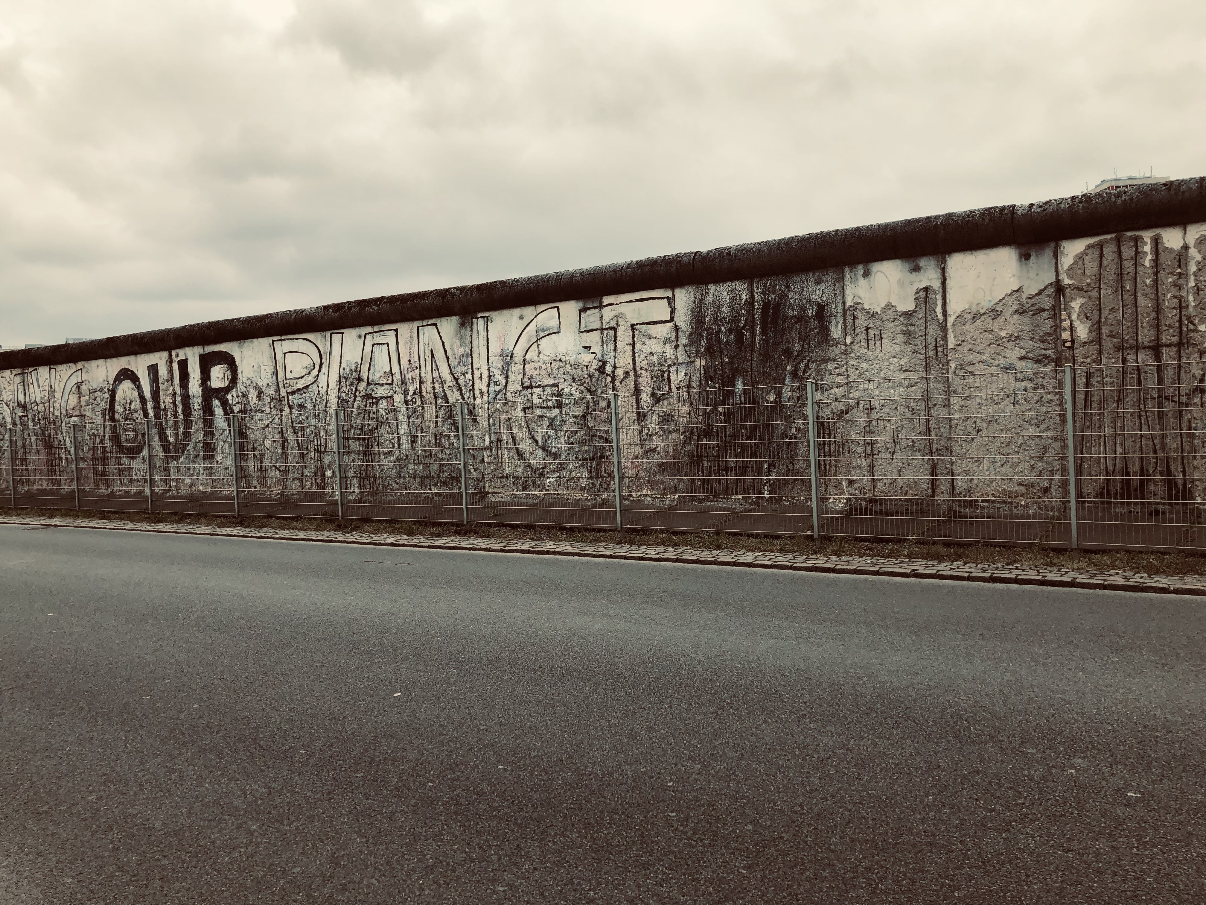 A section of the Berlin wall is left standing not to forget the horror of such a division among people in the hope that it would not happen again.