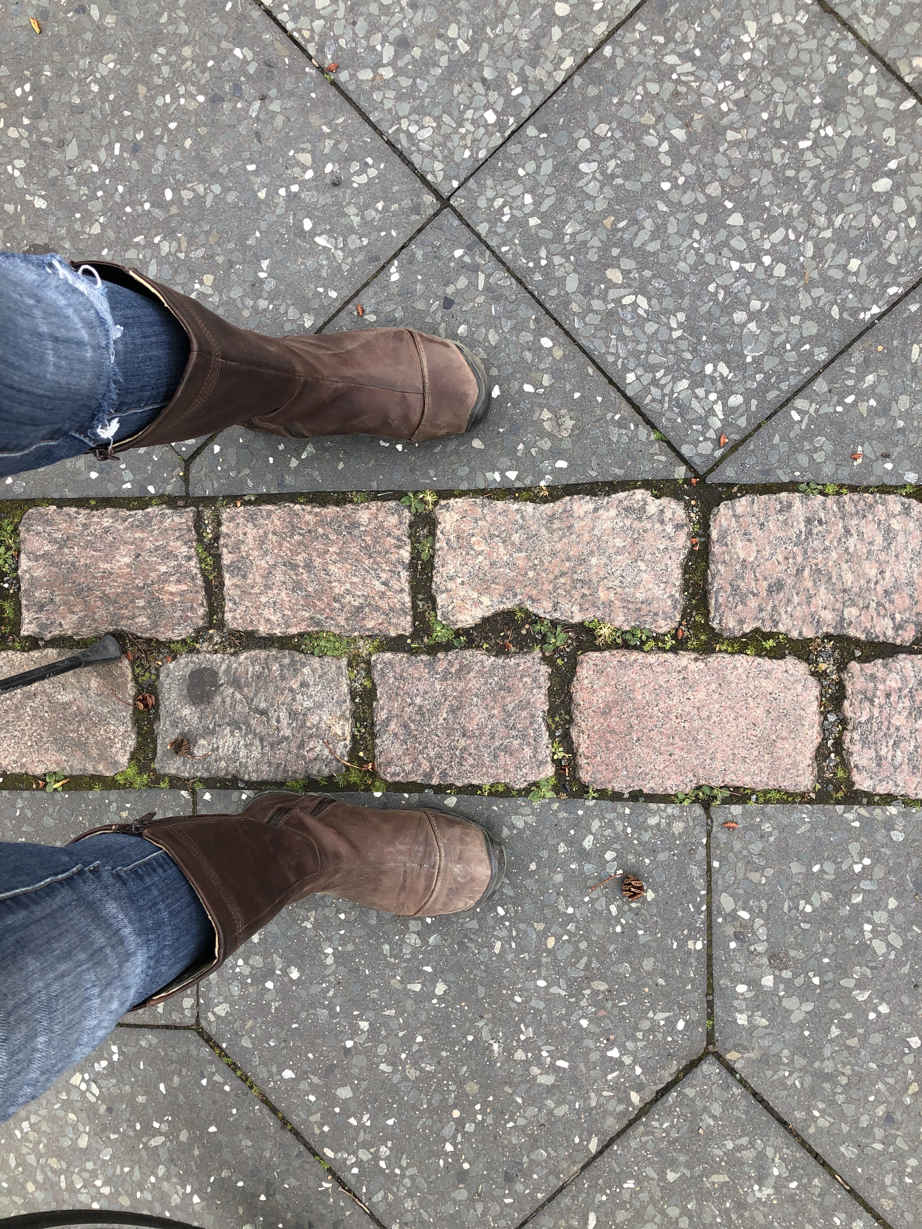 Today, we can stand peacefully with one foot in the former East Berlin and one in the former West Berlin. This wall has fallen. What other walls need to be brought down?