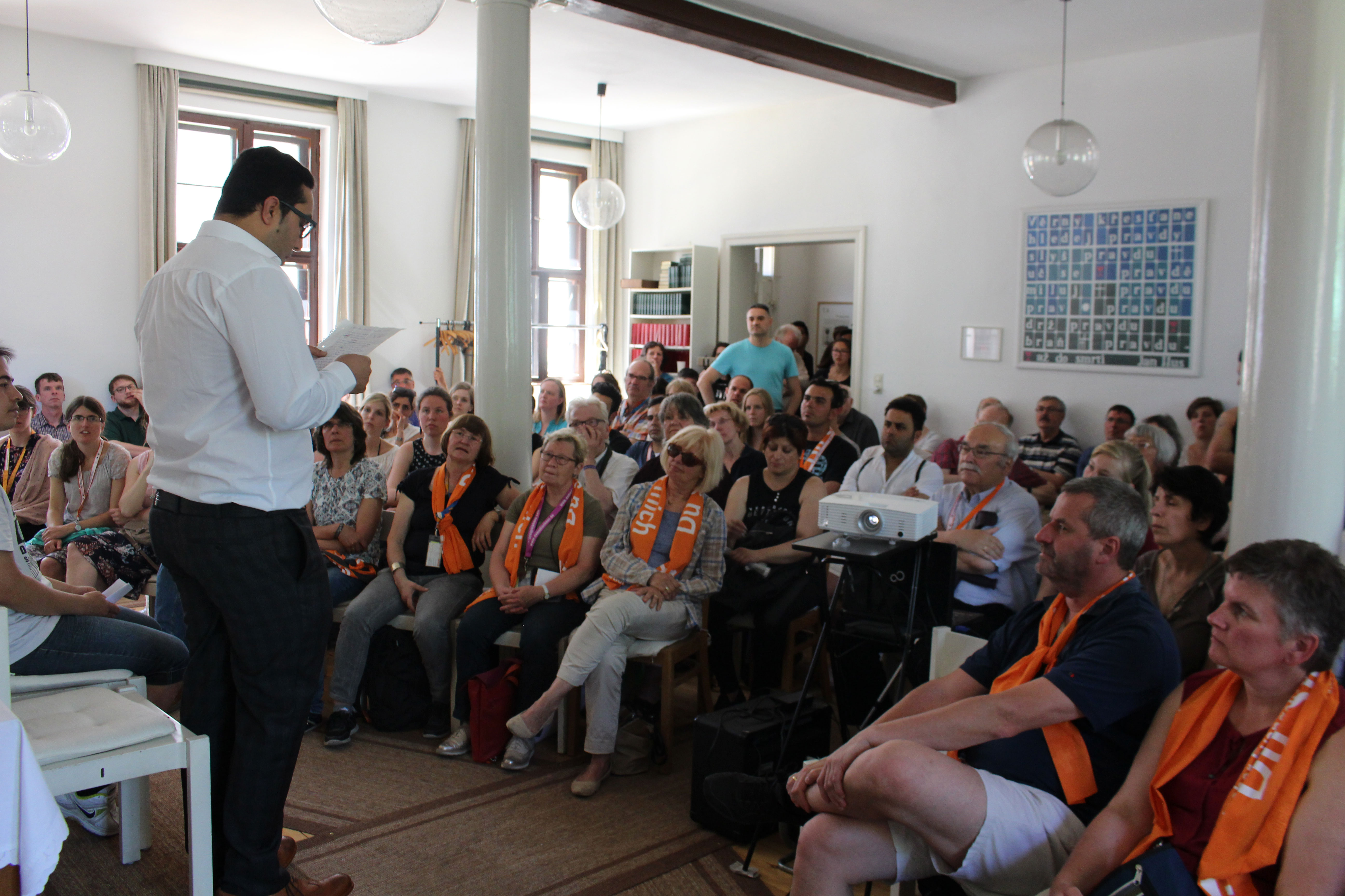 Man from the Iranian church sharing his story with the Kirchentag group