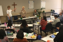 """(left to right) Faith Community Nurses Carmen Enz and Jean Harlow, and Rev. Aart van Beek (who often translated during the sessions) share on the topic of """"Models of Faith Community Nursing"""""""