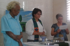 Josey serving the Lord's Supper with Rev. Beidi Casas and an elder