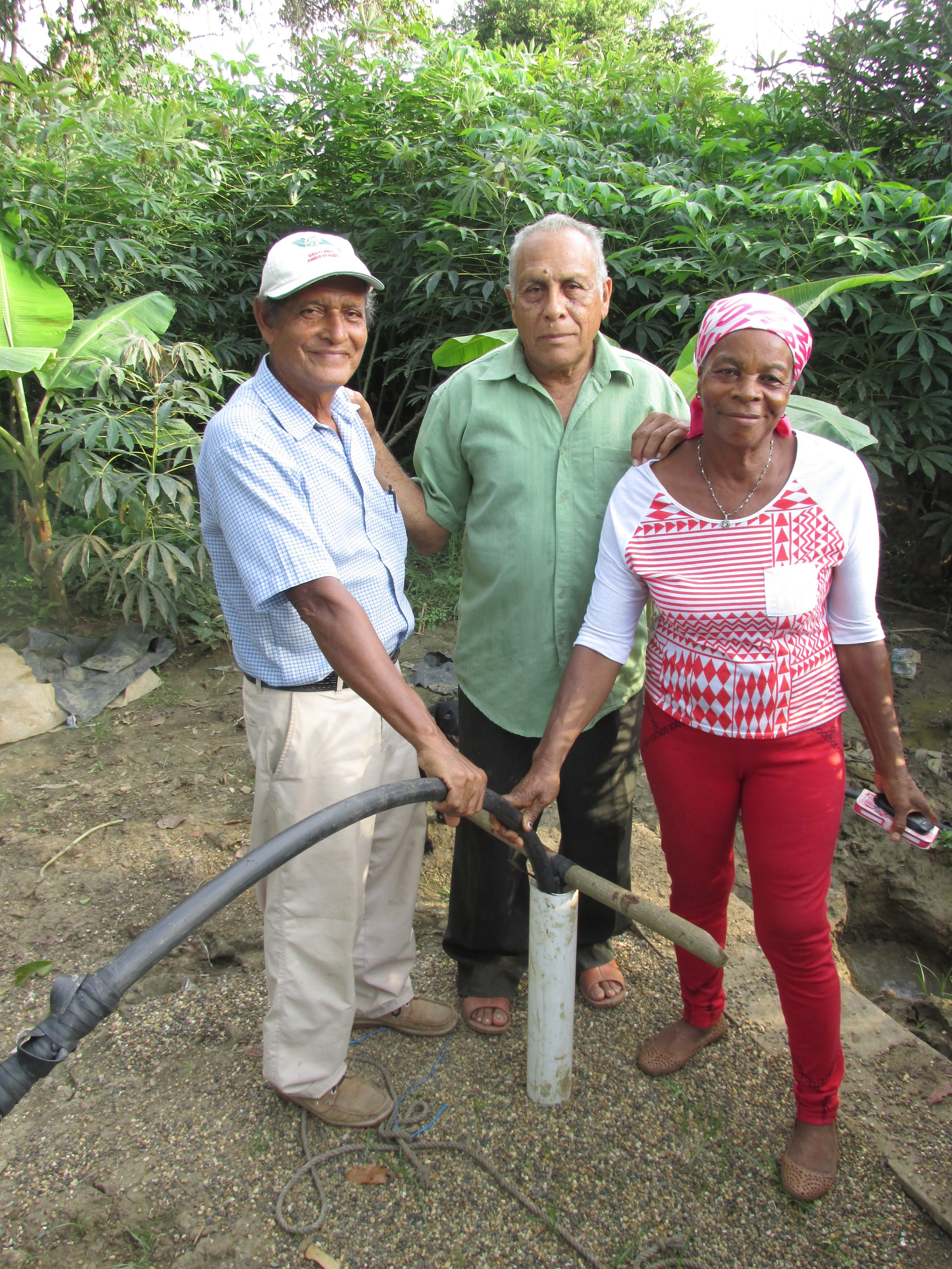 Three of the campesino farmers of María Jacinta show off their new well. Credit: Sarah Henken