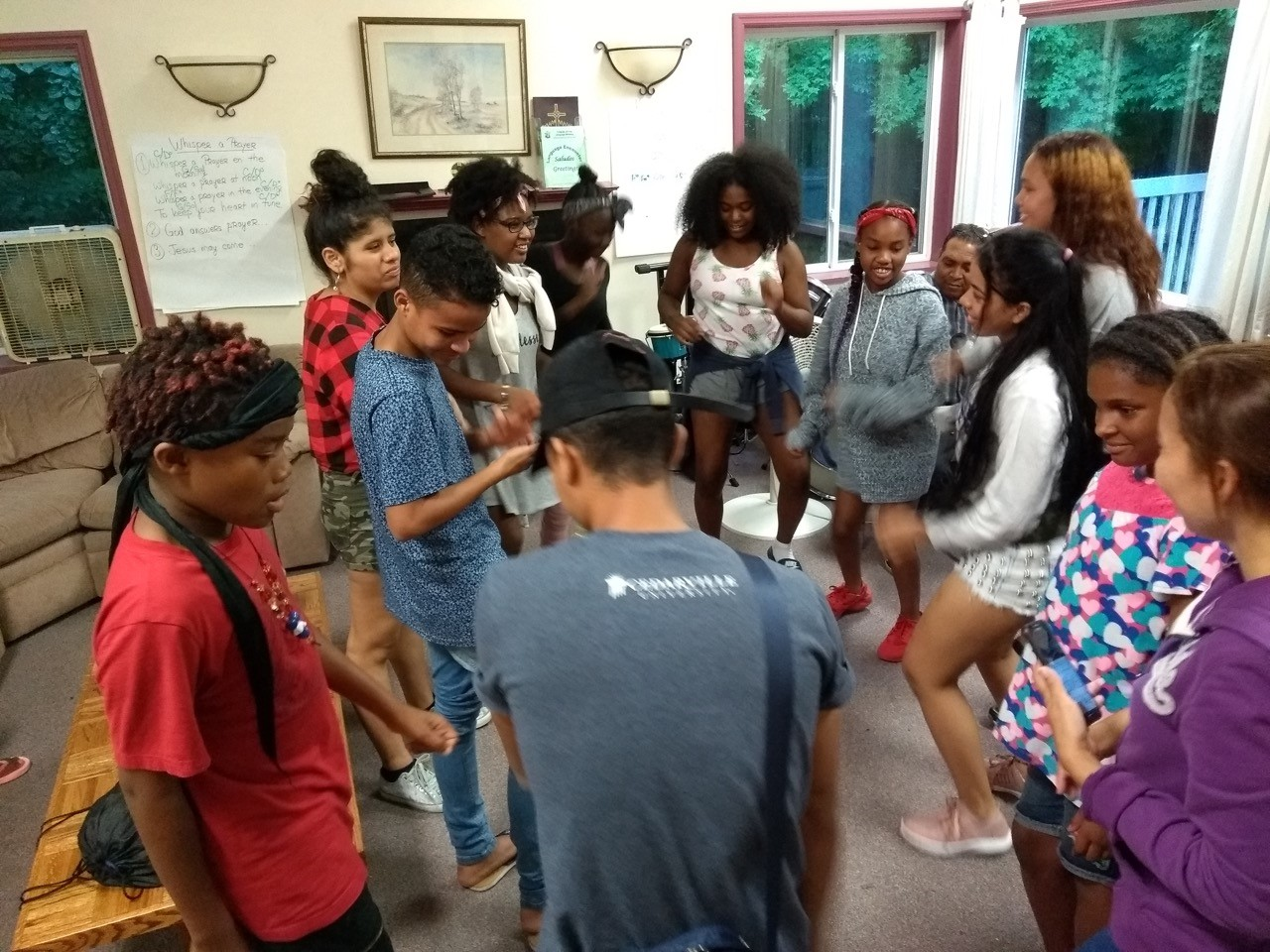 Young people from two countries enjoy music and dance together.