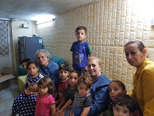Mayada and Susan with some of the children who are imprisoned with their mothers because no other family is available to care for them.