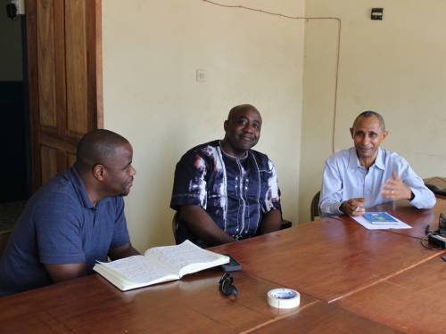 The Rev. Alonzo Johnson of Self-Development of People (left) and Valery Nodem with the Presbyterian Hunger Program (center) meet with Joseph Rahall of Green Scenery (right) to discuss land grab issues during a meeting in Freetown. (Photo by Rick Jones)