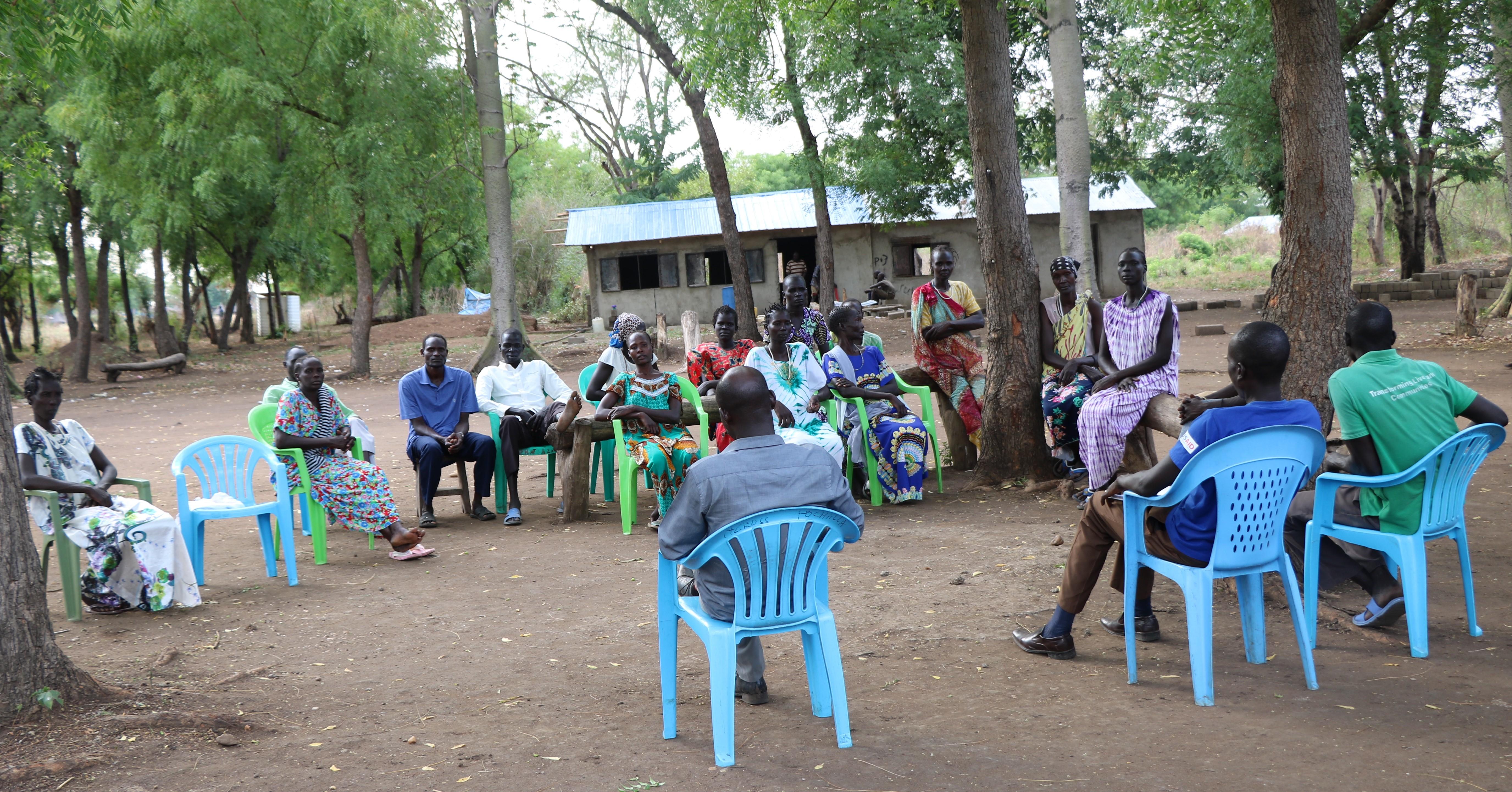 Concerned parents in Pochalla, South Sudan, strategize regarding increasing primary school attendance.
