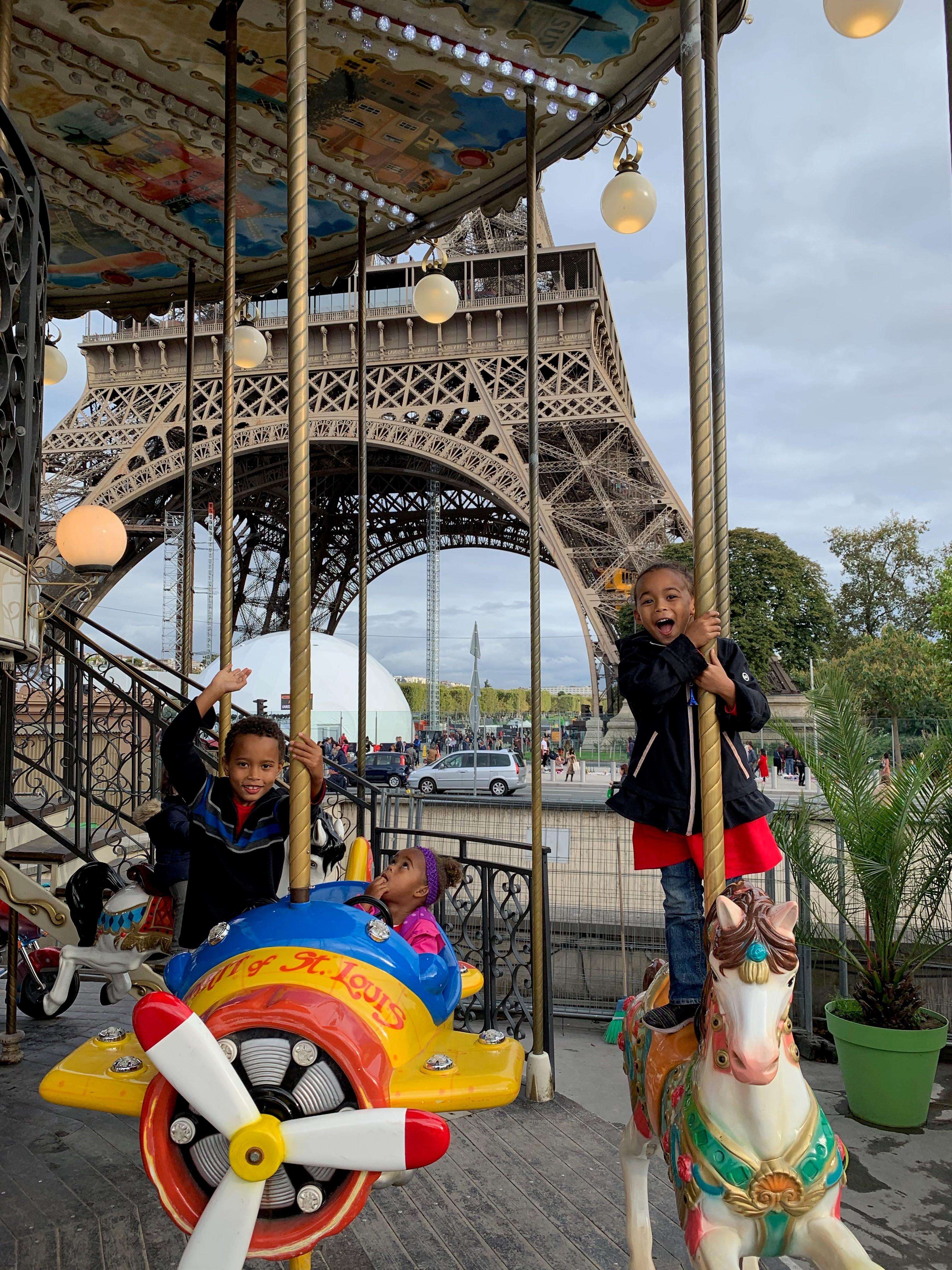 """A carousel at the foot of the Eiffel Tower - """"Bonjour!"""""""