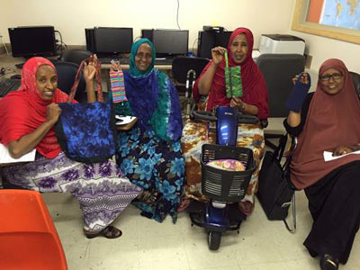 Participants in the Sewing Cooperative at Capital Park showcase their products. (Photo courtesy of Capital Park)