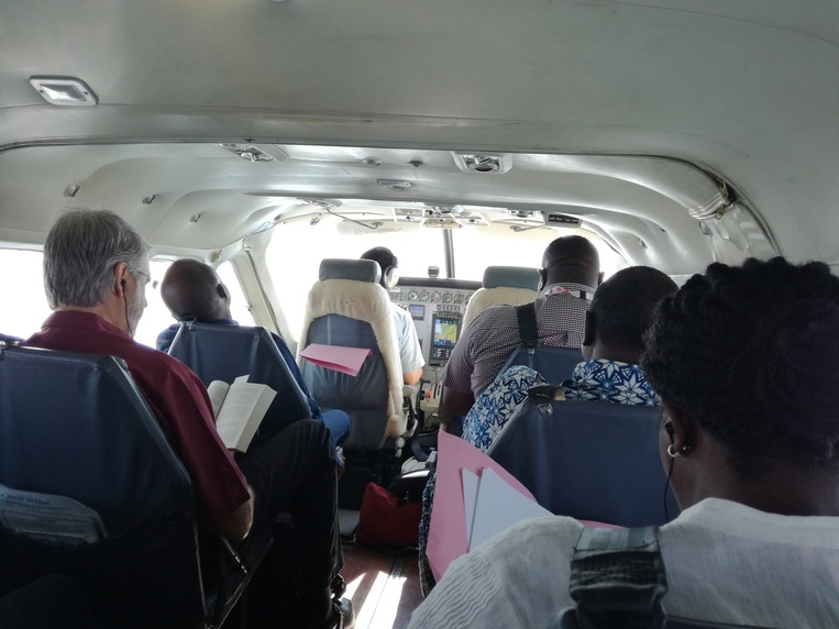 In flight to visit health zones in the Kasai Province on a Mission Aviation Fellowship (MAF) plane.